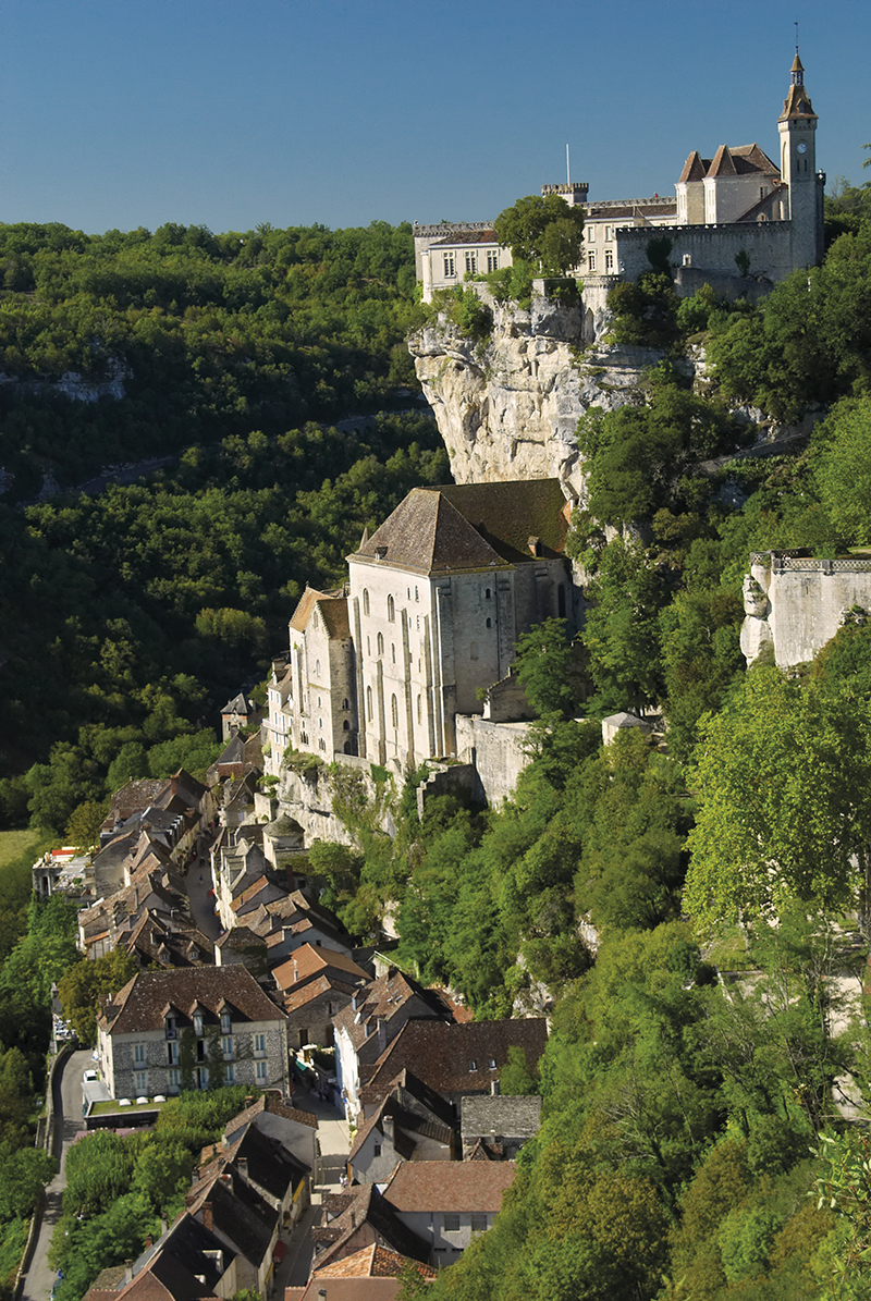 """The spectacular medieval town of Rocamadour in France, built into a vertical limestone cliff face. In the middle ages, Pilgrims on their way to Santiago di Compestela in Spain would stop here and ascend the 216 steps, on their knees, to the shrine of Our Lady at the top of the plateau. Some pilgrims still do so today."""